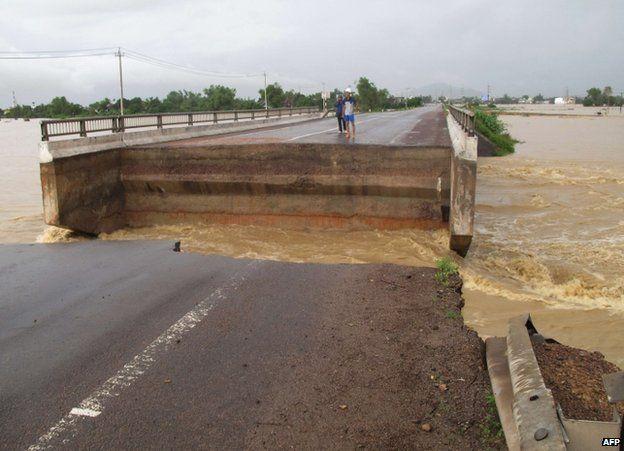 A bridge shattered by flooding in Binh Dinh province, Vietnam, 16 November