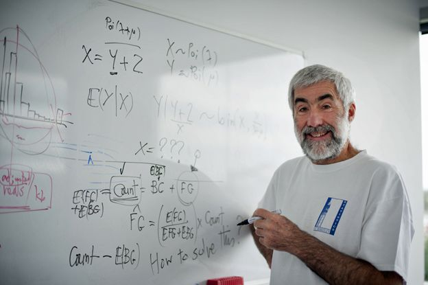 Terry Speed in front of a whiteboard