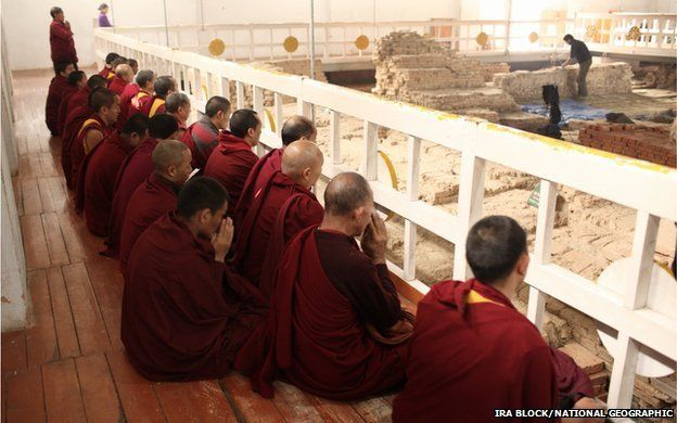 Monks within the Maya Devi Temple at Lumbini in Nepal