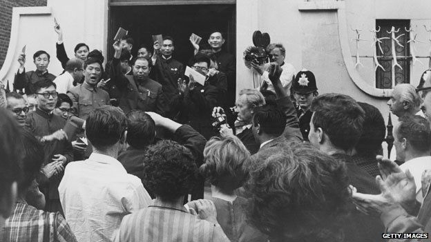 British supporters of the communist People's Republic of China listen as a Chinese diplomat exclaims Long live Chairman Mao, outside the Chinese Secretariat in Portland Place, London