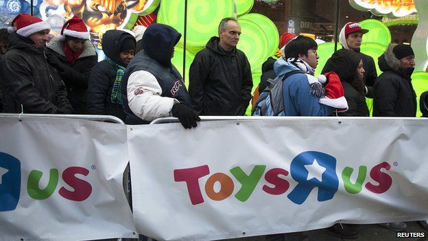 People line up outside a Toys'R'Us store in Times Square before their Black Friday Sale in New York November 28, 2013.
