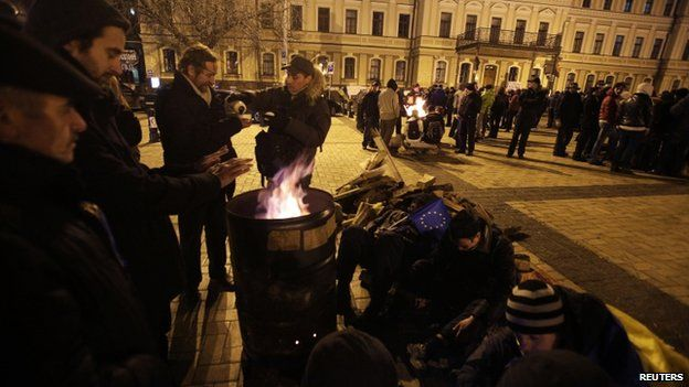 Protesters regrouped in front of St Michael's Golden-Domed Monastery late on Saturday
