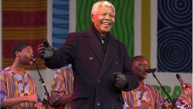 Nelson Mandela dancing on stage with Ladysmith Black Mambazo, 2001