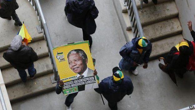 Crowds at a memorial service for Nelson Mandela, 10 Dec