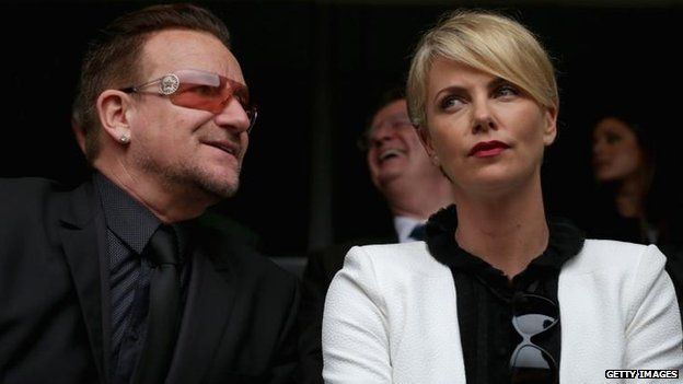 Bono and Charlize Theron attend the ceremony, 10 Dec