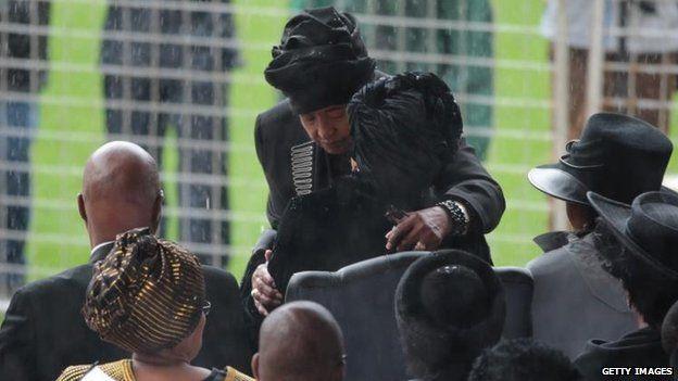 Ex-wife Winnie Madikizela-Mandela hugs widow Graca Machel, 10 Dec
