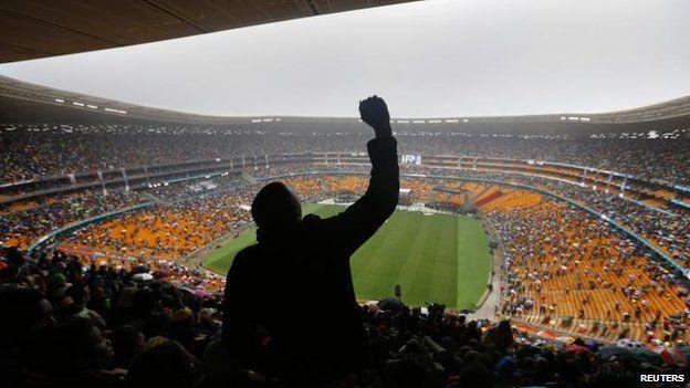 Man cheers Barack Obama's speech at Nelson Mandela's memorial, FNB stadium, Johannesburg (10 December)