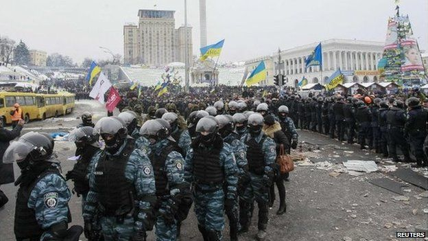Riot police leave Independence Square in central Kiev on Wednesday