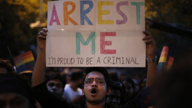 An Indian gay rights activist holds up a placard during a protest after the country's top court ruled that a colonial-era law criminalizing homosexuality will remain in effect in India in New Delhi, India, Wednesday, Dec. 11, 2013.