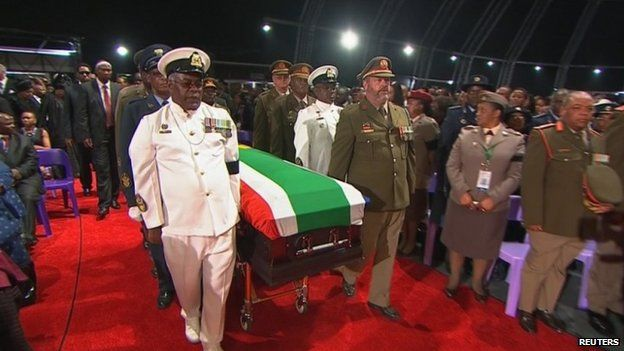 The coffin of Nelson Mandela is carried by military honour guard