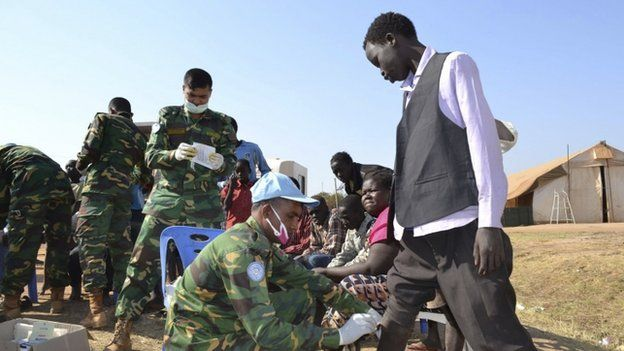 Medic peacekeepers from the United Nations Mission in the Republic of South Sudan treat civilians at their compound in the outskirts of Juba.