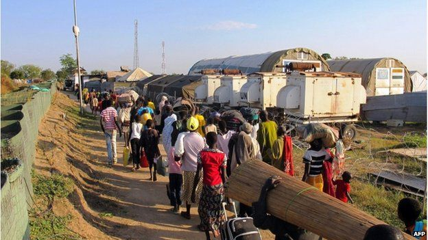 Civilians walking inside the Unmiss compound in Bor on 18 December.