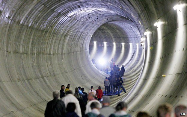 Visitors walking through Leipzig city tunnel in 2008