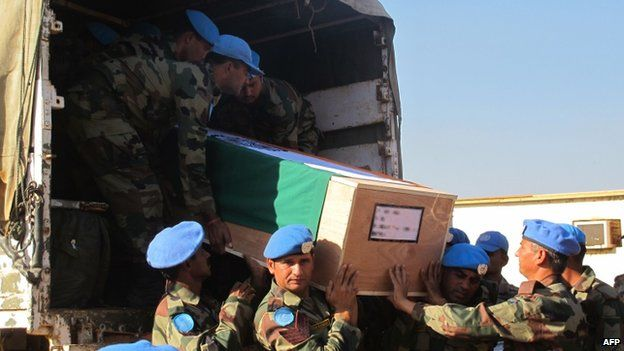 The remains of two Indian UN peacekeepers are transported for a memorial ceremony in Juba. Photo: 20 December 2013