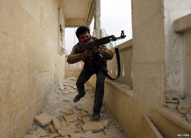 A rebel gunman in Aleppo, 4 December 2013
