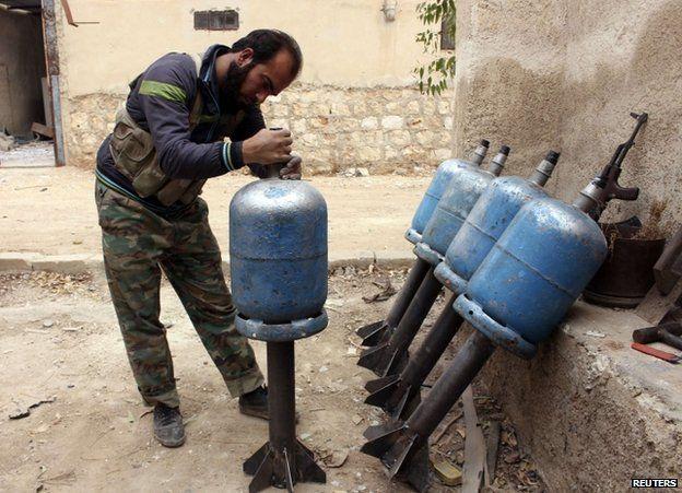 A rebel prepares rockets in Aleppo, 11 November 2013