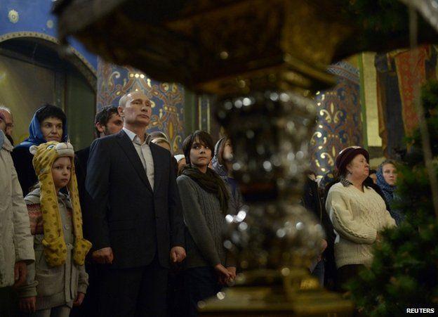 Russian President Vladimir Putin in church in Sochi, 6 January