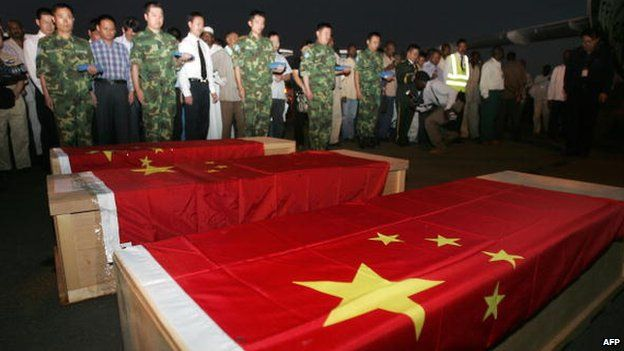 The coffins of Chinese oil workers killed in a kidnapping in Sudan - October 2008
