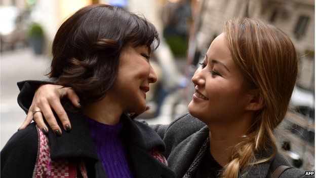 Alma Shalabayeva (L) is welcomed by her daughter Madina as she arrives for a press conference after she arrived in Rome on December 27, 2013