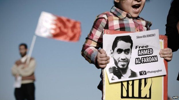 A child calls for the release of Ahmed Fardan at a protest in Bahrain (3 January 2014)