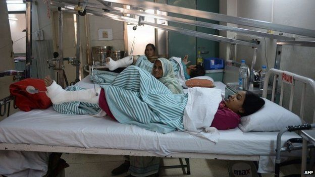 An Indian polio patient lies on a bed during treatment at St. Stephens Hospital in New Delhi. I