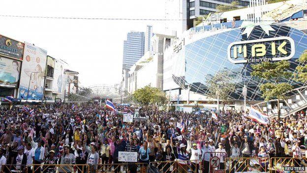Anti-government protesters gather outside MBK shopping mall in central Bangkok on 14 January 2014