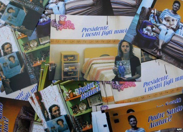 Postcards made by the Association against Illegal Dumps show mothers posing with pictures of their children who died of cancer in the Naples-Caserta area, 24 November 2013