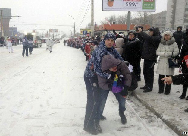 A security guard restrains gay rights protester Pavel Lebedev at the Olympic relay in Voronezh, 18 January