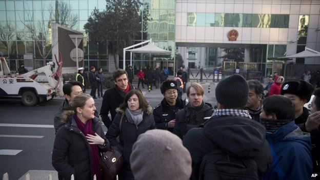 Chinese policemen try to block foreign diplomats talking to journalists as they prepare to attend a trial of Xu Zhiyong outside the Beijing's No. 1 Intermediate People's Court, China, 22 January 2014