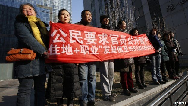 Supporters of Xu Zhiyong, one of China's most prominent rights advocates, shout slogans near a court where Mr Xu's trial is being held, in Beijing, 22 January 2014
