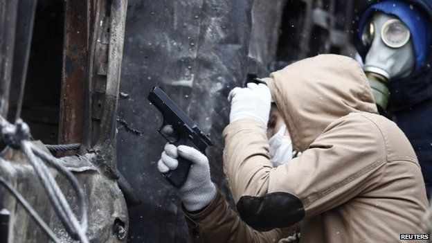 Protester holds a pneumatic gun during clashes