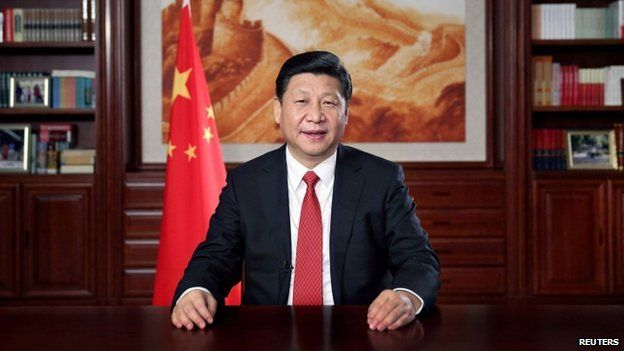 China's President Xi Jinping delivers his new year's speech in front of state media in Beijing, 31 December 2013