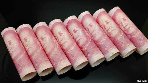Chinese 100 Yuan banknotes seen in this illustration picture in Beijing November 5, 2013