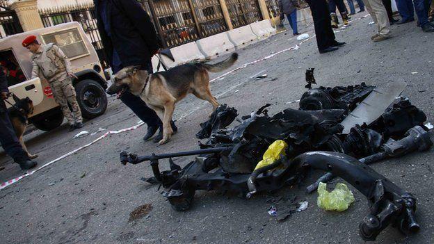 Scene of car bomb blast in Cairo on 24 January 2014