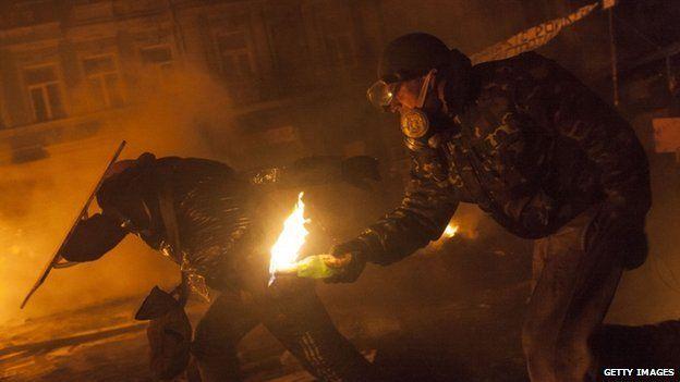 Anti-government protesters attack police near Dynamo Stadium in Kiev, Ukraine, on 24 January