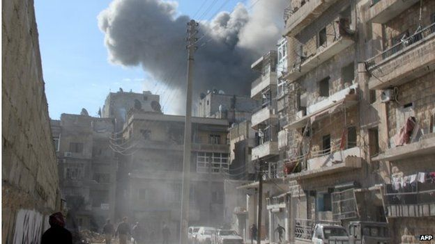Smoke billows following an alleged air strike by Syrian government forces on January 31