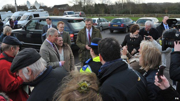 Prince Charles arrives at the Williams Hall in Stoke St Gregory, Somerset, to meet local residents and emergency service workers