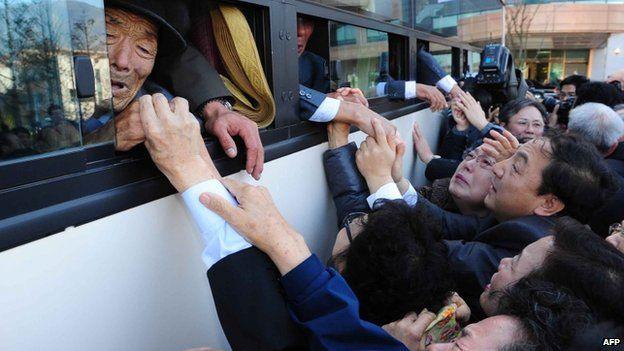 File photo: North Koreans (in the bus) grip hands of their South Korean relatives as they bid farewell following their three-day separated family reunion meeting at Mount Kumgang resort, North Korea, 1 November 2010