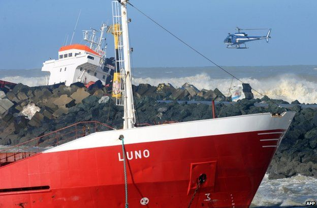 A helicopter approaches the stricken Luno, at Anglet on the French Atlantic coast, 5 February