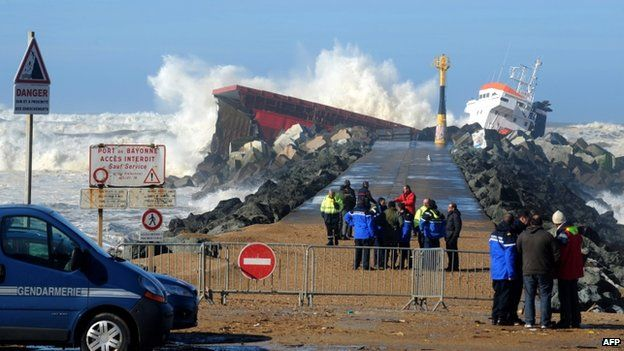 Emergency workers observe the stricken Luno, at Anglet on the French Atlantic coast, 5 February