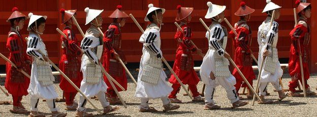 Japanese pupils carrying out a traditional ceremony in Osaka