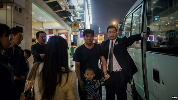 Hotel guests are evacuated near the site where a World War Two-era bomb was discovered in Hong Kong on 6 February 2014