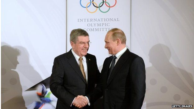 IOC president Thomas Bach (left) welcomes Russia's president Vladimir Putin (Right) to a Gala dinner in Sochi on 6 February