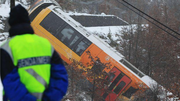 Gendarme watches the wreckage of a train near Digne-les-Bains (8 Feb)