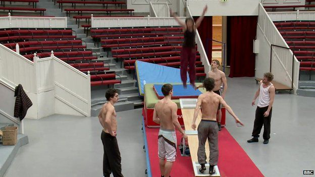 A team of circus acrobats practicing their jumps