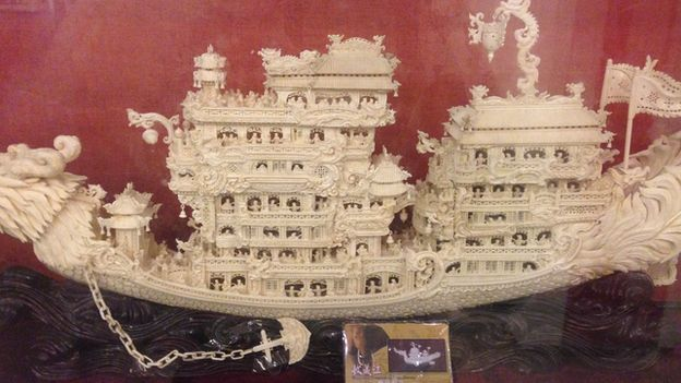 A carved ivory ship model, with an ID card that does not match, in a legal ivory shop