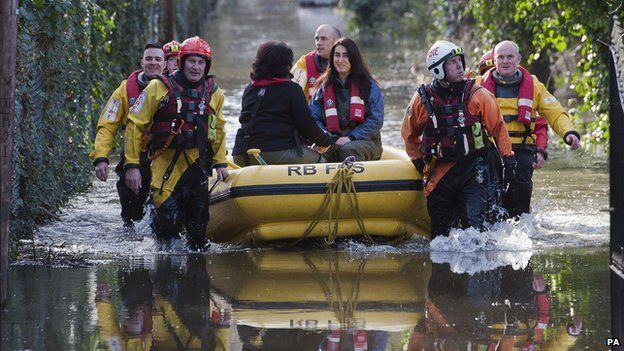 Berkshire fire and rescue crews rescue residents whose houses have been flooded in Staines-upon-Thames