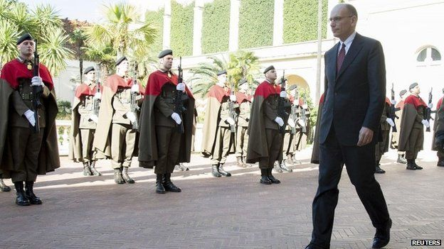 Italian PM Enrico Letta arrives at the presidential palace to hand in his resignation 14 February 2014