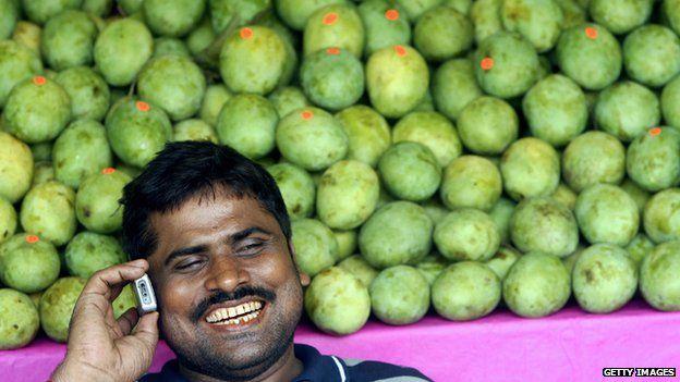 Mango seller on the phone