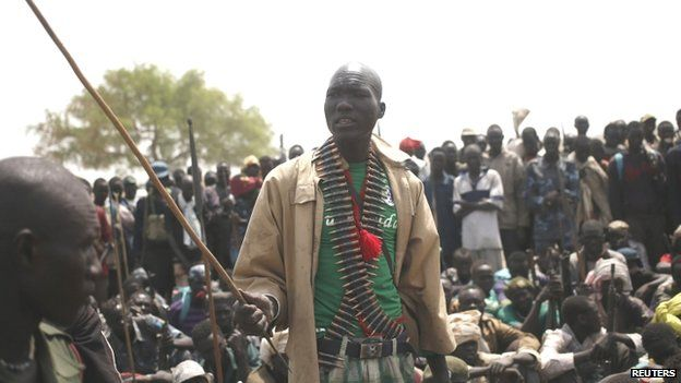 A rebel fighter talks to his comrades in a rebel-controlled territory in Upper Nile State (16 February 2014)